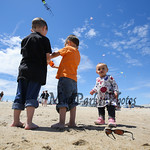 Louis Perez (3) and his friends Eli (3) and Anna (1) Harris of Manchester fly their kites at the Kites Against Cancer to benefit The Beyond the Rainbow Fund of Exeter Hospital on Sunday at t ...
